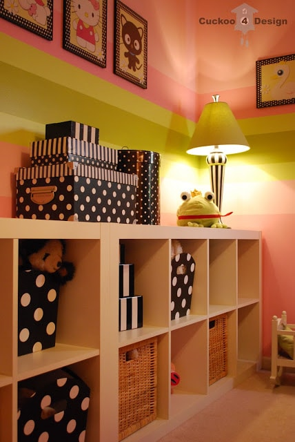 black and white polka dots and stripes with pink striped walls