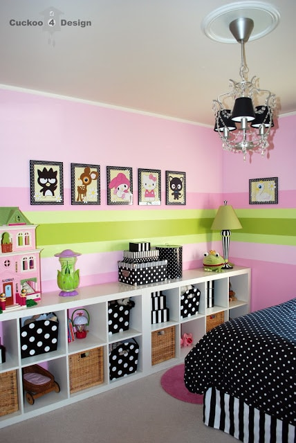 black and white polka dots and stripes with pink striped walls and Ikea furniture