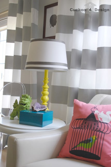 tangerine painted lamp, louis ghost chair, horizontal stripe curtains