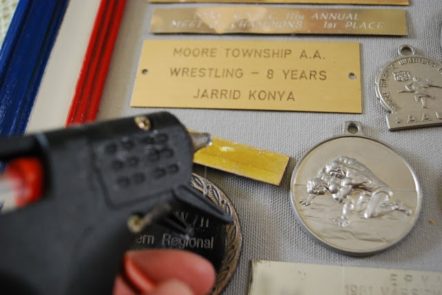 attaching plaques and medals with hot glue