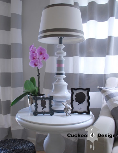 painted brass lamp with grey, white and pink stripes