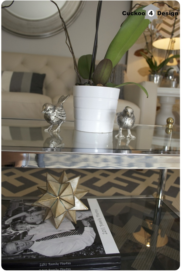 coffee table vingette with brass, chrome and orchid