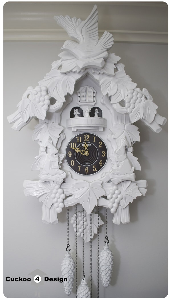 large modern white cuckoo clock with dancing angels