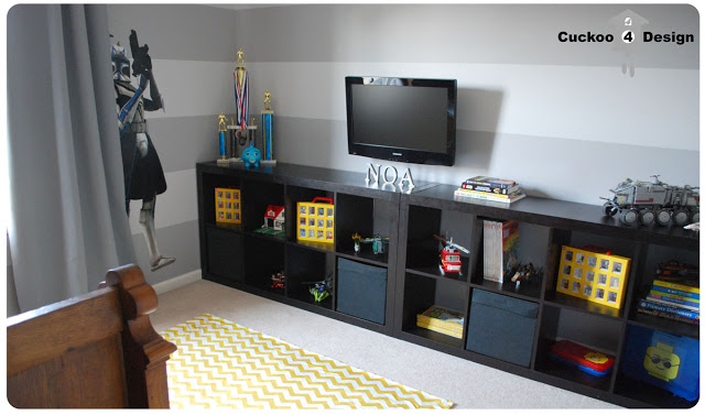 grey horizontal striped room with star wars and lego
