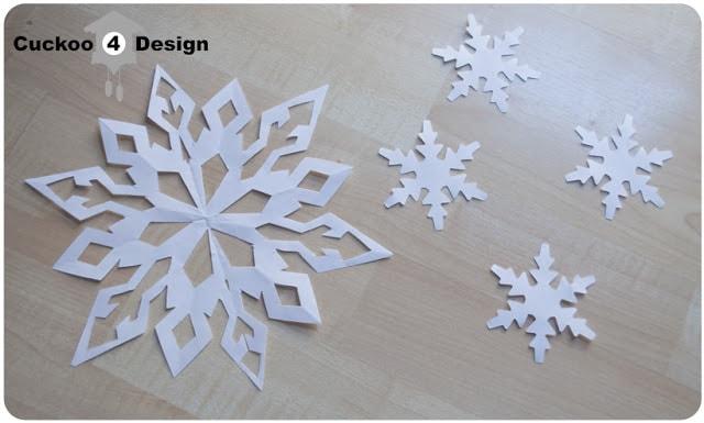 white cut paper snowflake