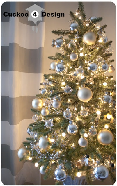 beautiful faux tree with silver, clear and ivory Christmas balls
