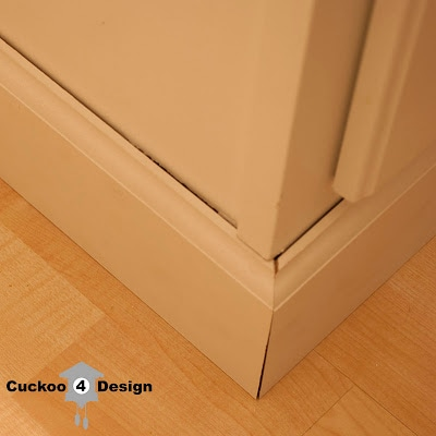base molding around standard white vanity to replace bathroom cabinet kick plate