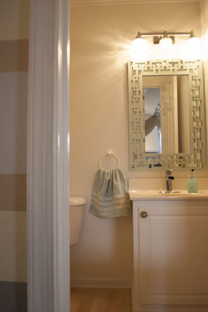 powder room makeover in mint green and gold