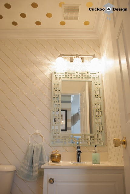 gold polka dot ceiling and gold striped walls