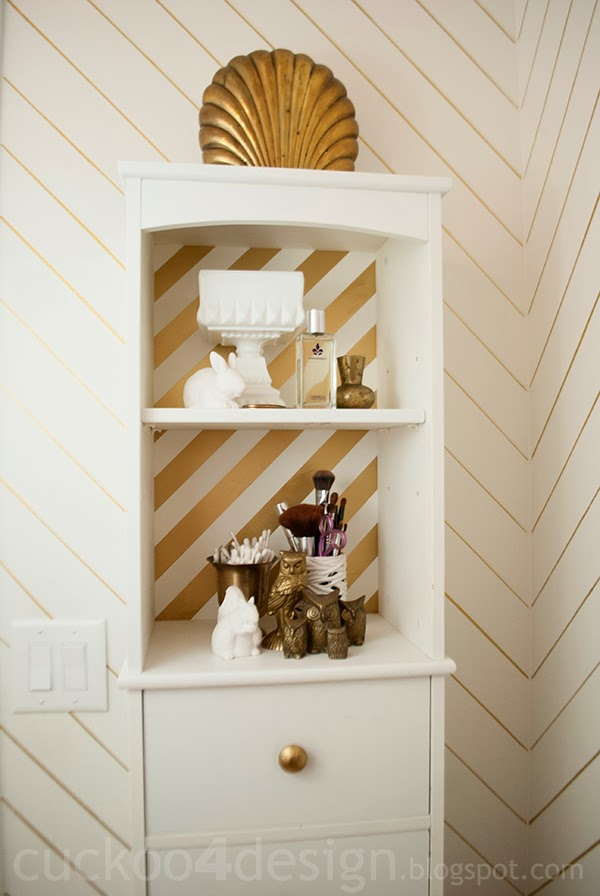 gold striped medicine cabinet with gold sharpie striped walls