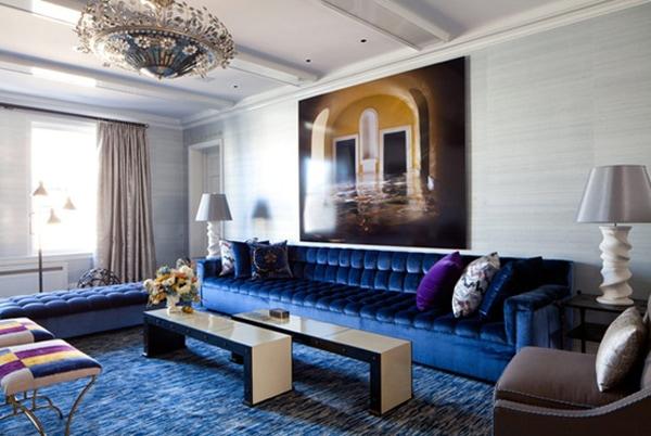 large blue button tufted sofa