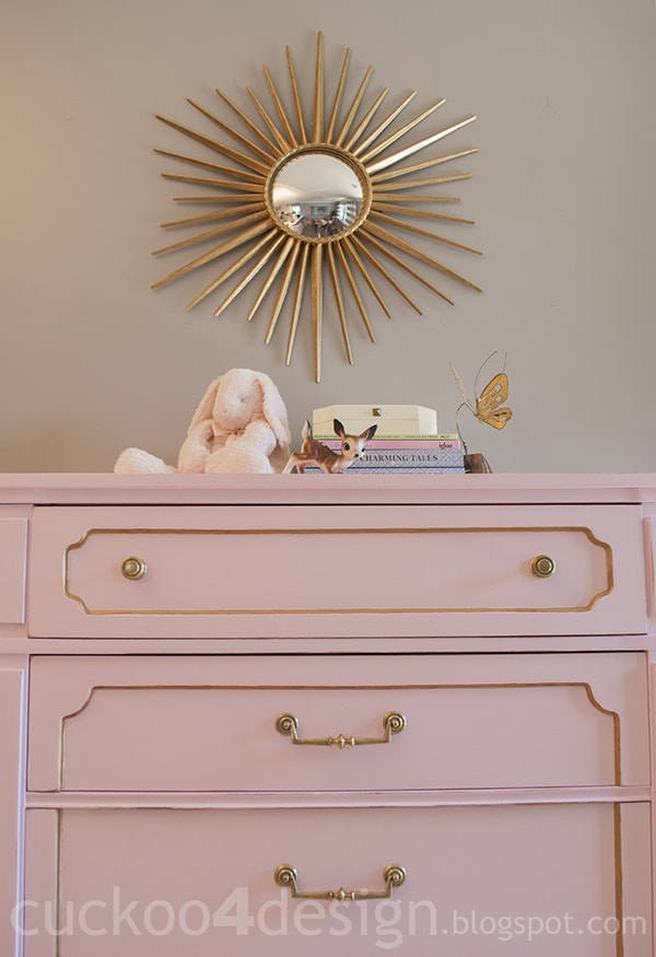 pink and gold nursery dresser