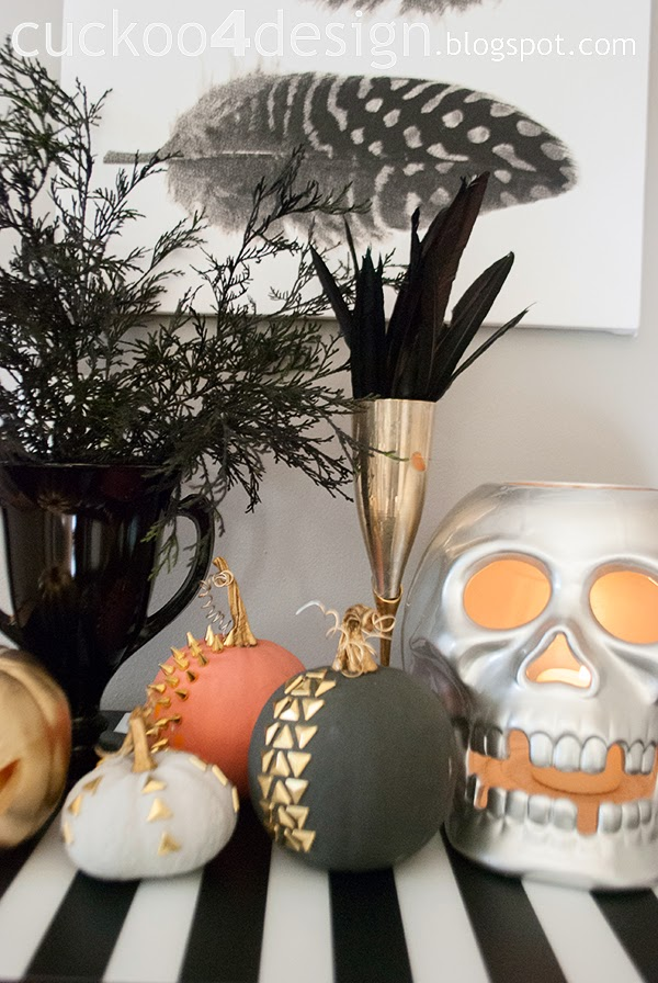 gold studded pumpkins and large silver skull