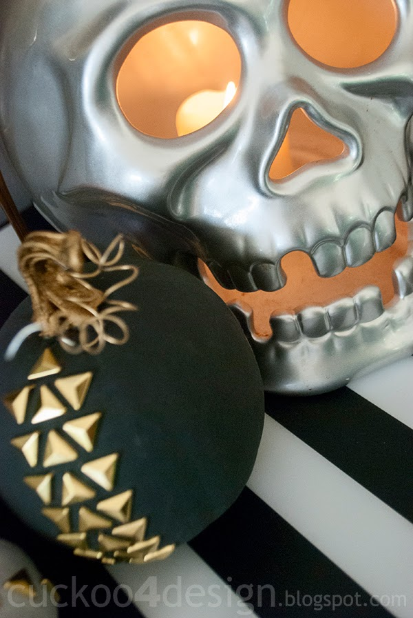studded pumpkins and large silver skull