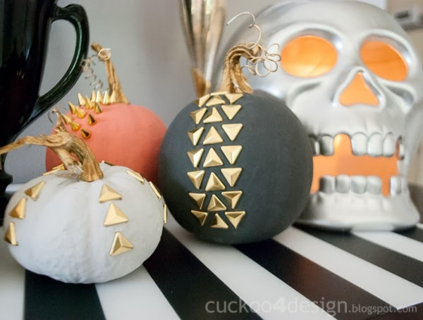 black feathers, studded pumpkins and large silver skull