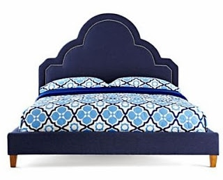dark blue velvet Jonathan Adler bed