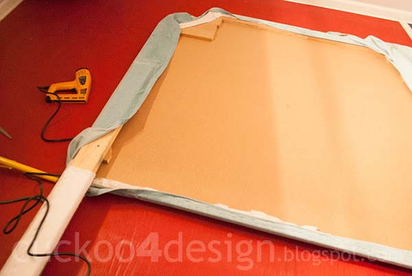 stapling the fabric to the DIY fabric headboard