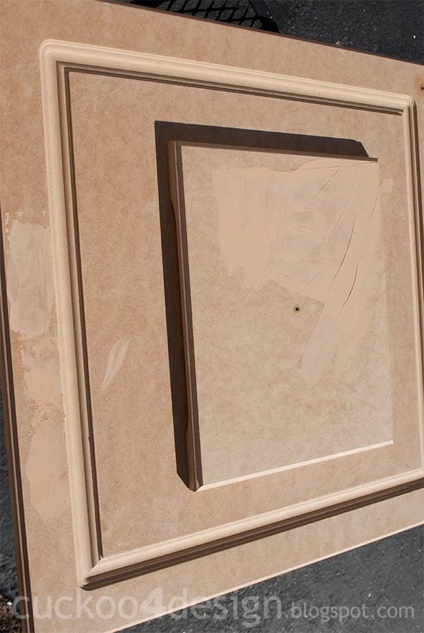 MDF kitchen door after laminate is peeled off and imperfections are patched