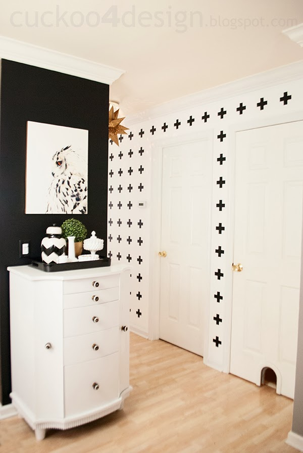 white wall with black crosses