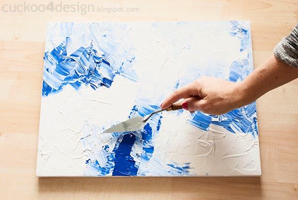 random patterns of white and blue acrylic paint on canvas