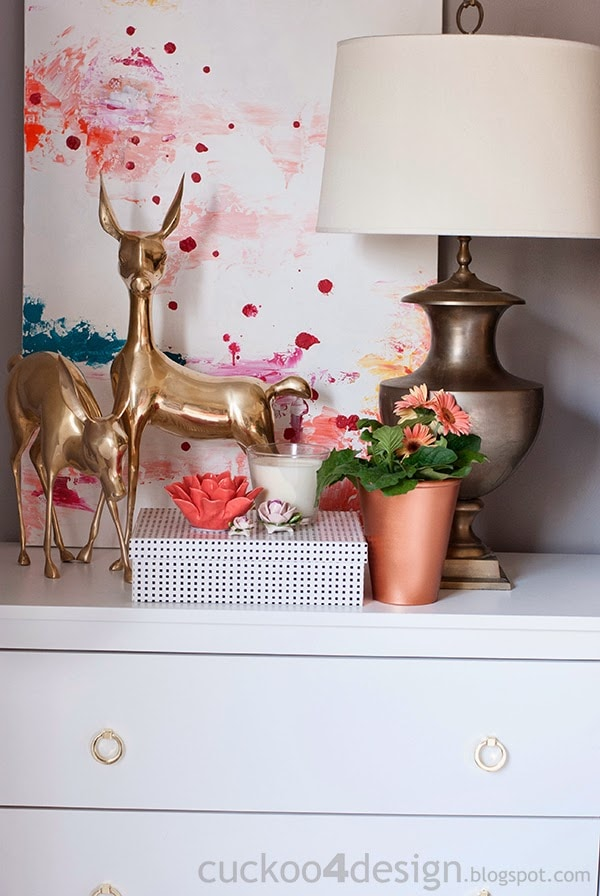 white nightstands with gold ring pulls and gold brass deer