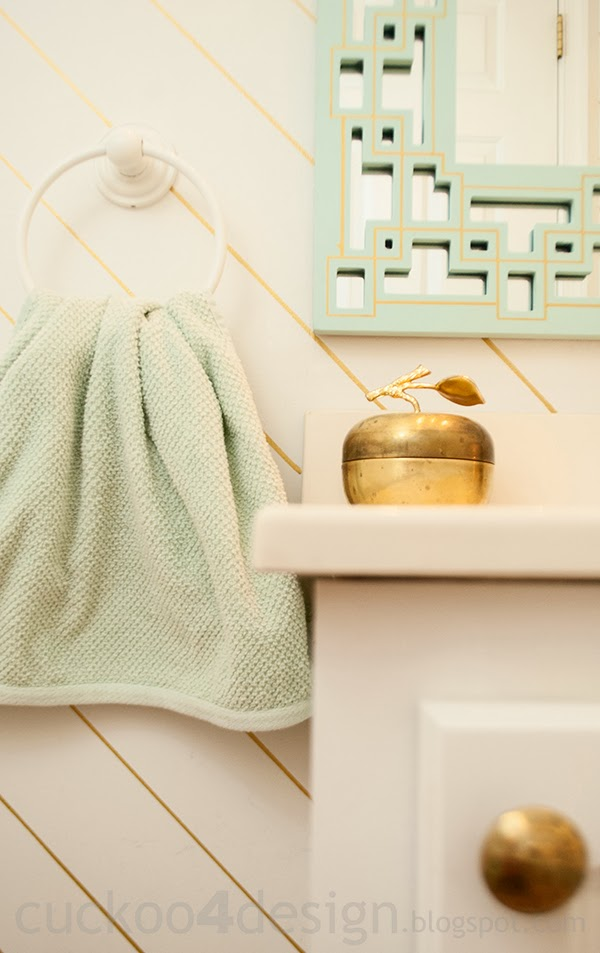 mint vanity mirror with gold sharpie walls