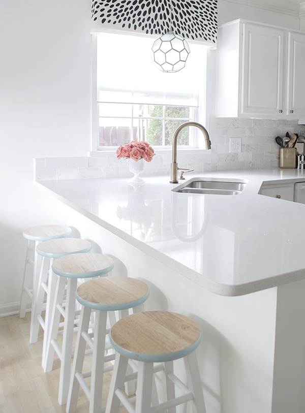 White kitchen with colorful accents