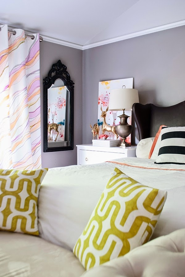 watercolor curtains hanging next to bed