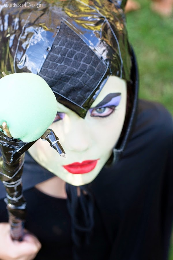 child with diy maleficent costume looking camera