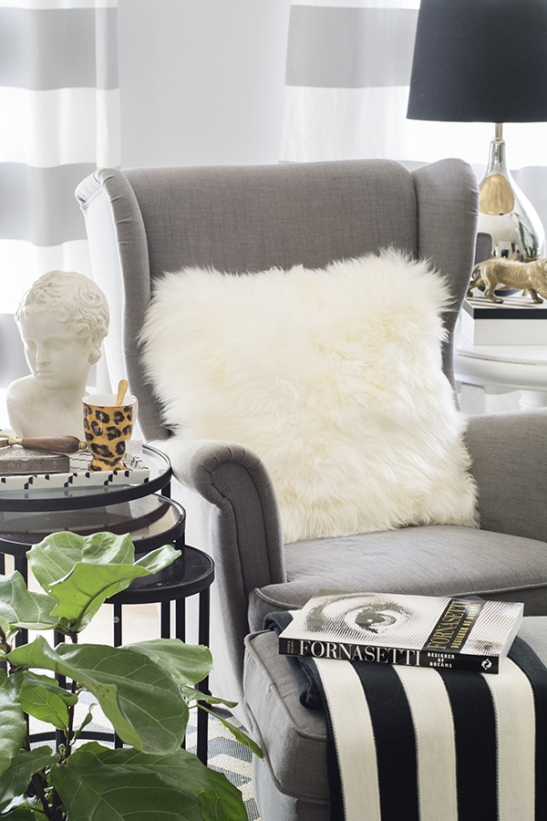 Ikea fur pillow and fiddle leaf fig tree