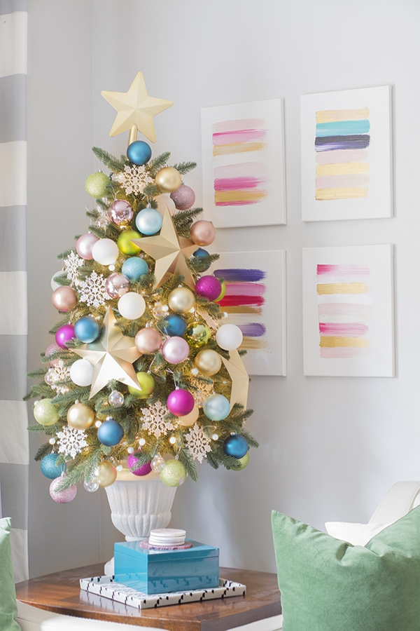 Colorful small Christmas tree with gold stars