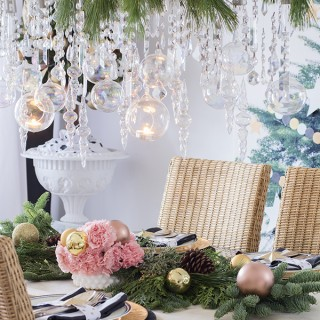 Christmas dining room decor with icicle chandelier and fresh greenery