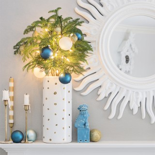 How to hide Christmas light cables on a fireplace mantel without garland