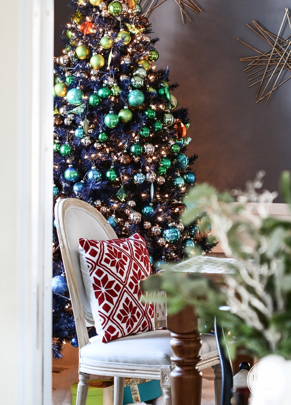 navy blue Christmas tree with colored ornaments