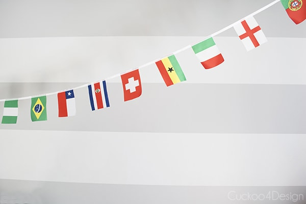 world cup flag banner and grey horizontal striped walls