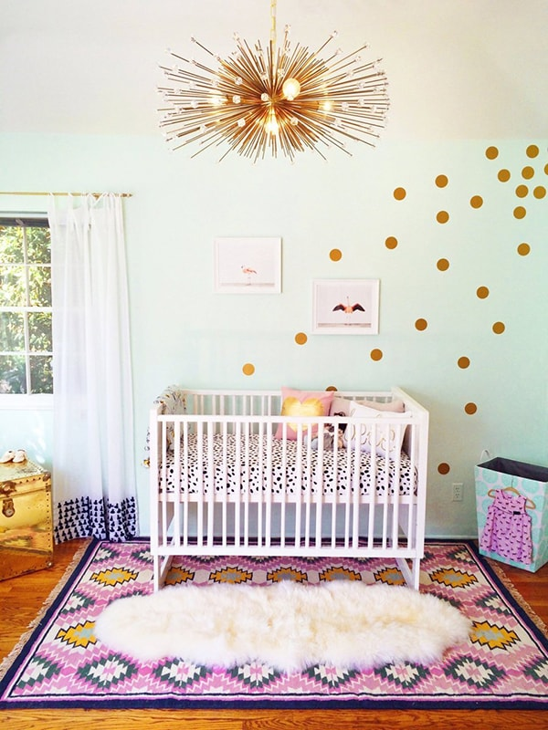 stylish girl nursery with vintage touch