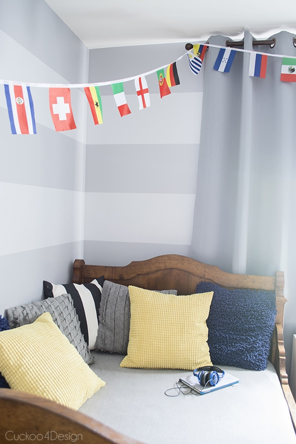 eclectic boys room with grey walls