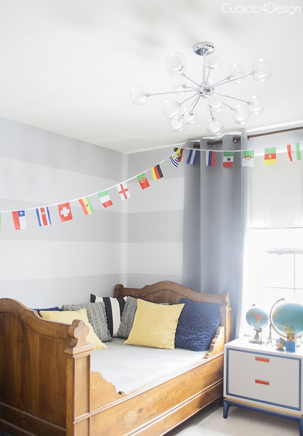 eclectic boys room with grey walls and silver sputnik fixture