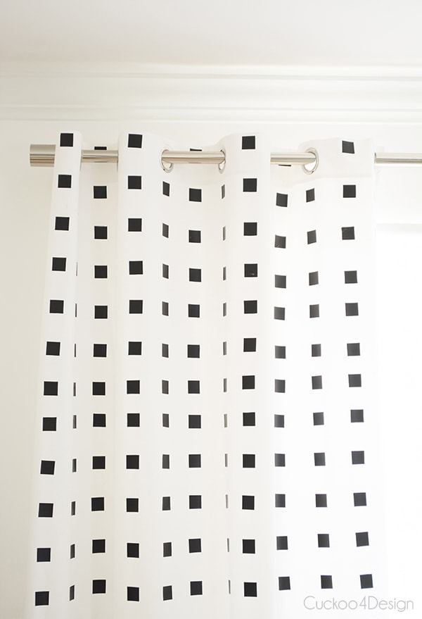 grommet view of black and white checkered curtains