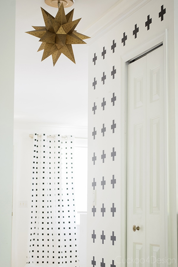 cross wall view with DIY black and white checkered curtains in the background