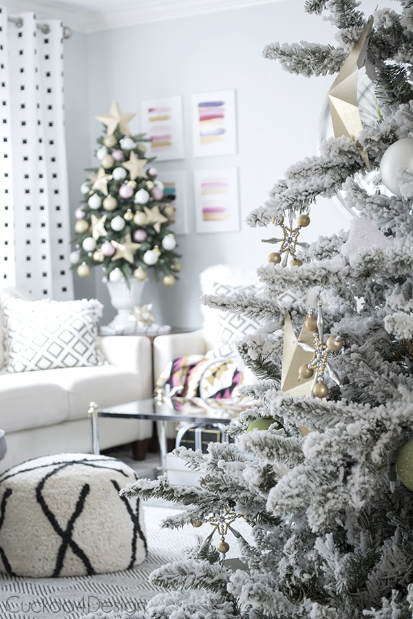 two pink and gold Christmas trees in living room
