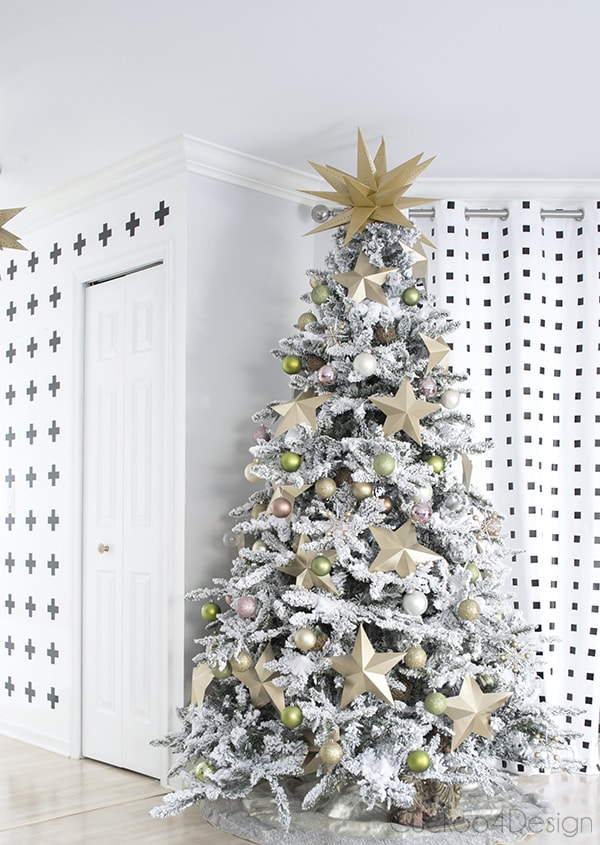 flocked faux Christmas tree with large gold stars