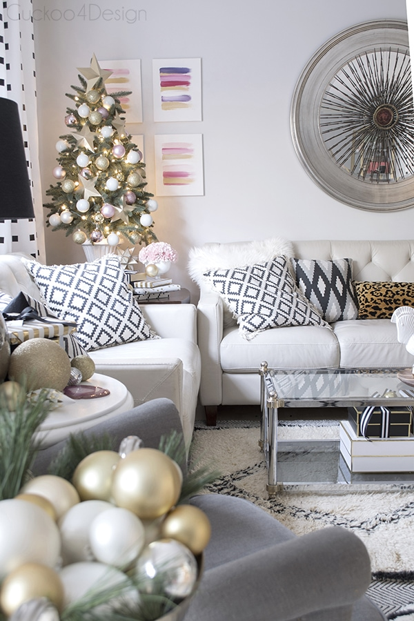 festive living room with pink and gold Christmas tree