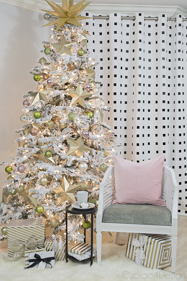 seating area in front of pink and gold Christmas tree