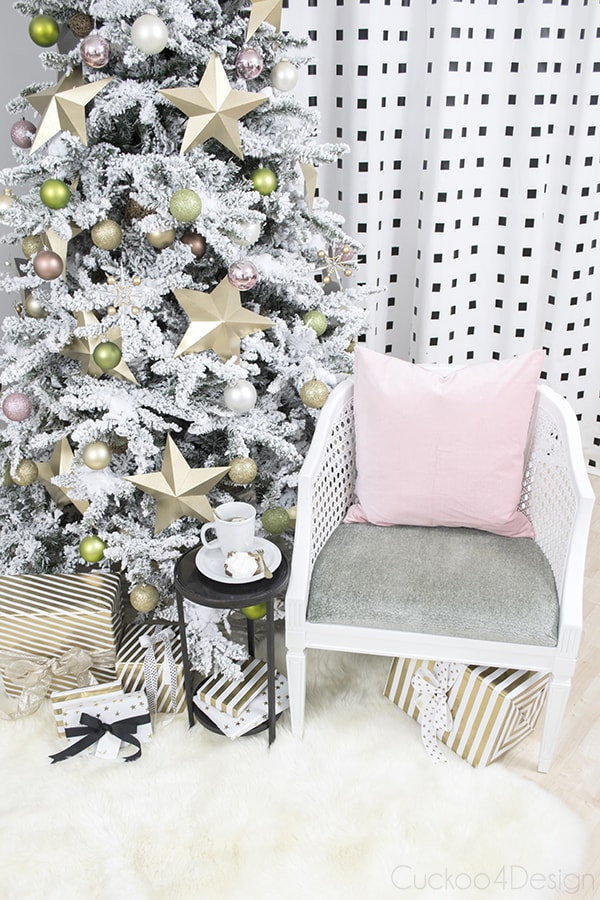 pink and gold Christmas tree with chair and pink pillow