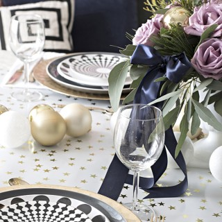 black, white, gold and blue Christmas dining room table setting