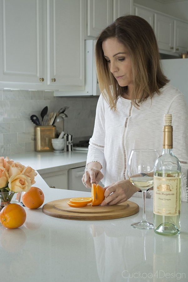 slicing orange for Aperol Spritz