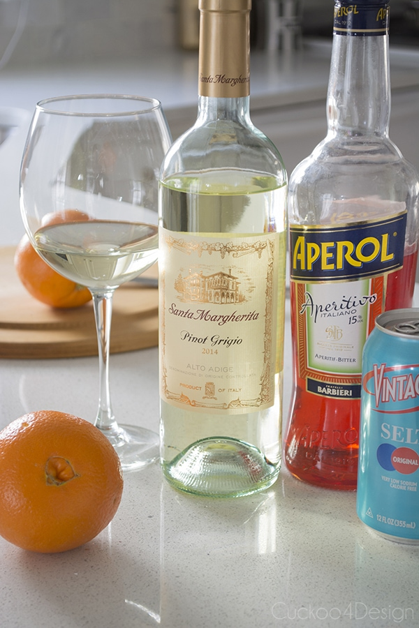 white wine, aperol, orange and seltzer used to make Aperol Spritz