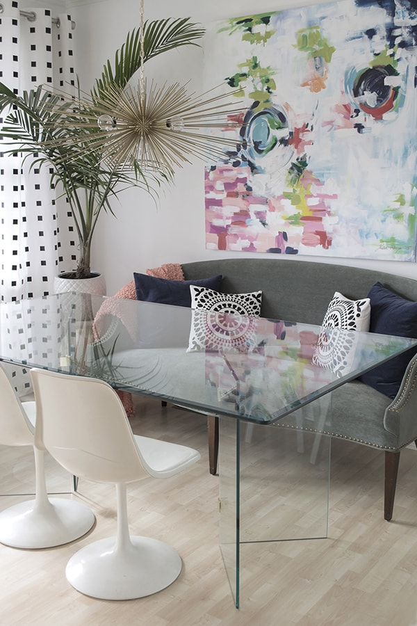 modern dining room with colorful abstract art