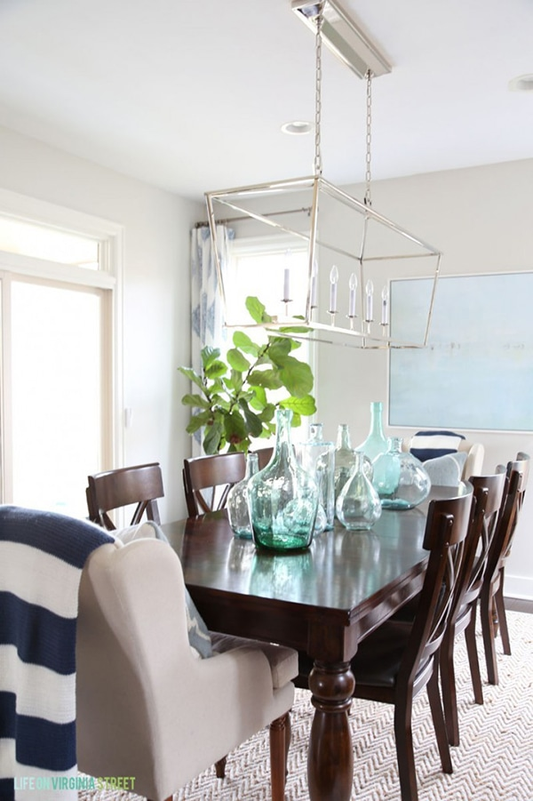Spring-Dining-Room-with-Navy-Stripes-and-Glass-Bottles-via-Life-On-Virginia-Street-682x1024